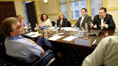 Glen Cove City Councilman Efraim Spagnoletti, far right,