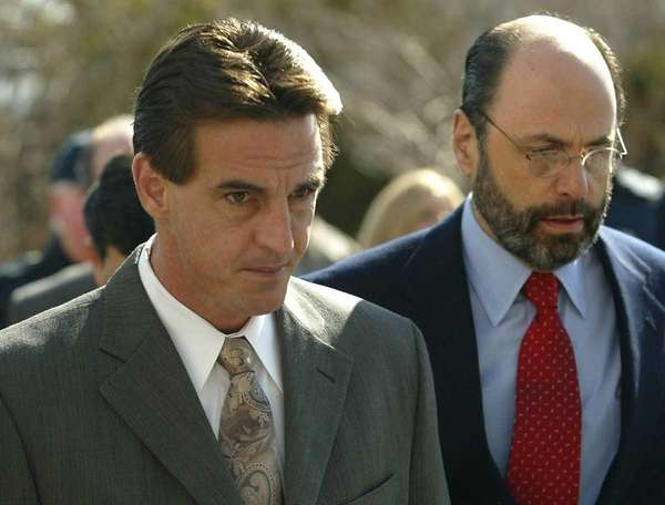 Daniel Pelosi, left, is escorted by his attorney