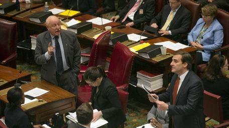 Sen. Kenneth LaValle (R-Mount Sinai), left, debates a