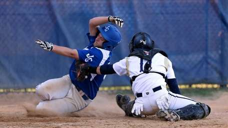 Glenn's Luke Citarella is tagged out at home