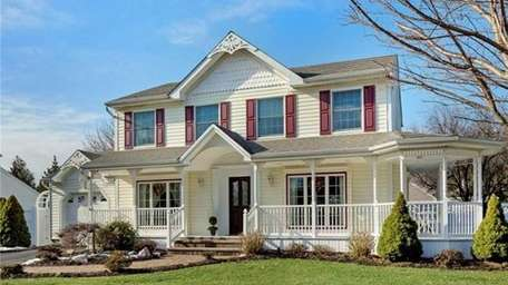 This house at 5 Tara Lane, Commack, is