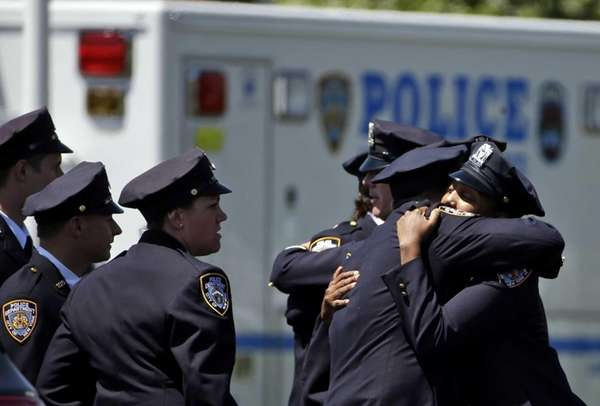 Police officers attend the wake for fallen NYPD