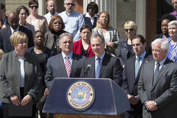 State Attorney General Eric Schneiderman speaks at a