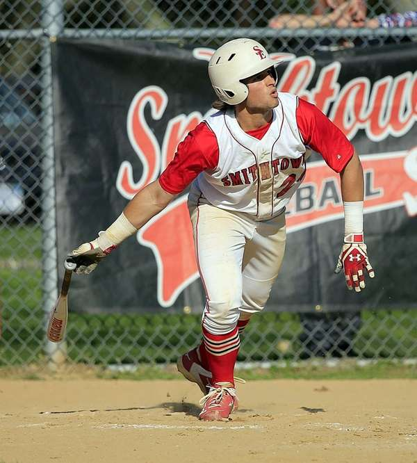 Smithtown East shortstop Pat Lagravinese follows the flight