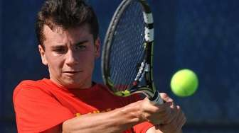 Chaminade junior Colin Sacco returns a volley during