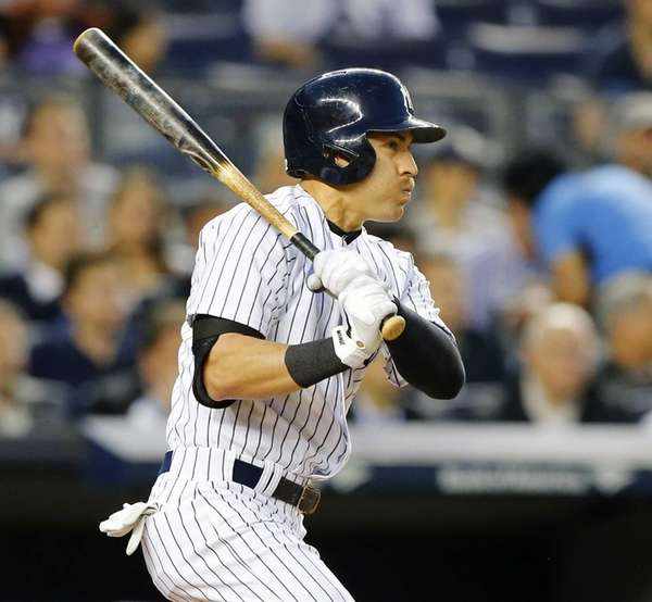 Jacoby Ellsbury of the Yankees follows through on