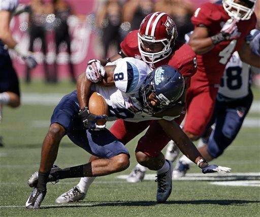 Massachusetts defensive back Trey Dudley-Giles tackles Maine wide