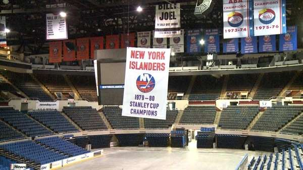 The Islanders' Stanley Cup banners were lowered from