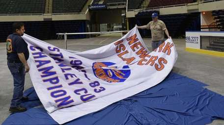 Nassau Veterans Memorial Coliseum workers John Armentano, left,