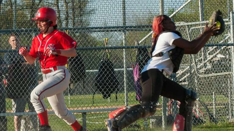 Smithtown East eighth-grader, Courtney Hohenberger, left, beats the