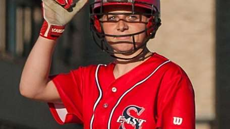 Smithtown East eighth-grader Courtney Hohenberger smiles after hitting
