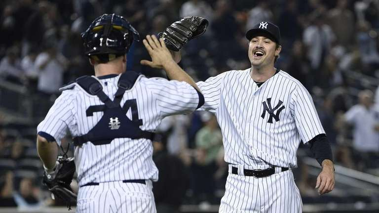 New York Yankees relief pitcher Andrew Miller celebrates