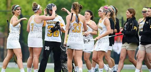 Adelphi goalkeeper Taylor Hayes is congratulated by her