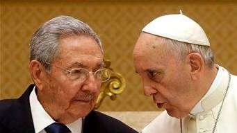 Pope Francis, right, talks with Cuban President Raul