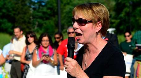 Carol Burris speaks during a rally against common
