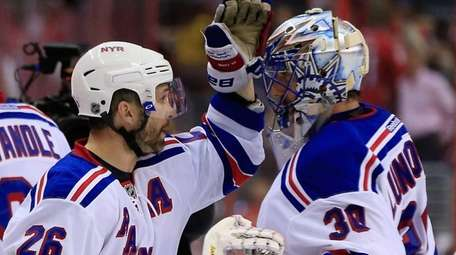 Martin St. Louis and Henrik Lundqvist of the