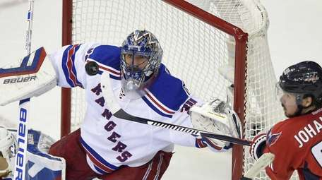 New York Rangers goalie Henrik Lundqvist watches the
