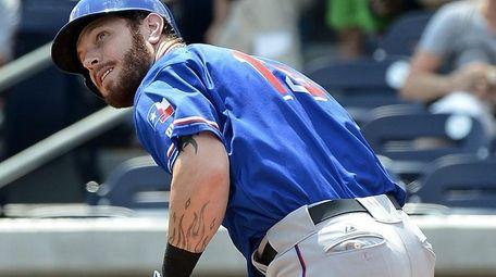 Texas Rangers' Josh Hamilton singles to left field