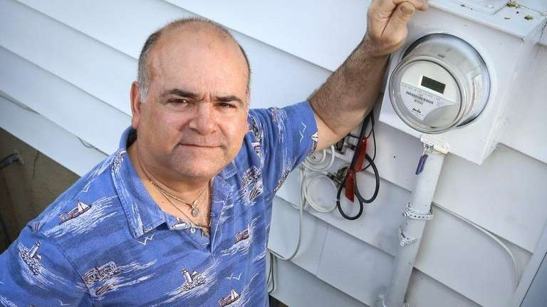 Mike Pedano stands near the electric meter outside