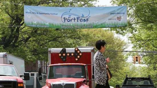 A banner for Port Fest hangs from utility