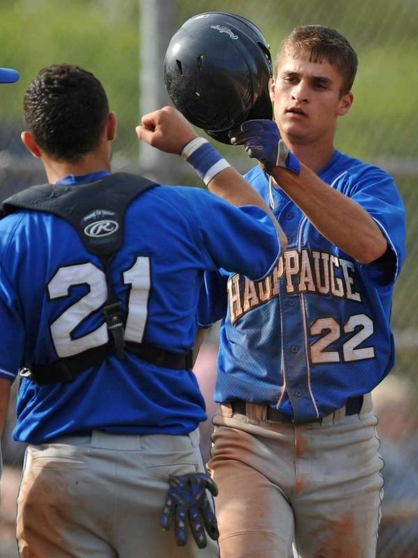 Hauppauge pitcher No. 22 Nick Fanti, right, gets