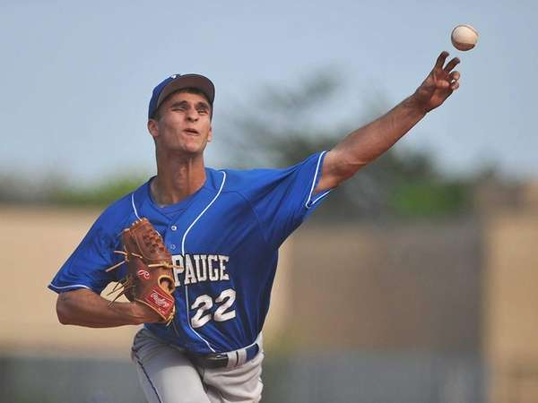 Hauppauge pitcher No. 22 Nick Fanti delivers to