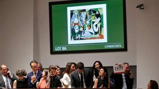 Employees take bids on Pablo Picassos Women of