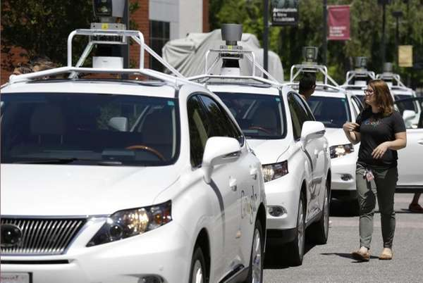 A row of Google self-driving Lexus cars at