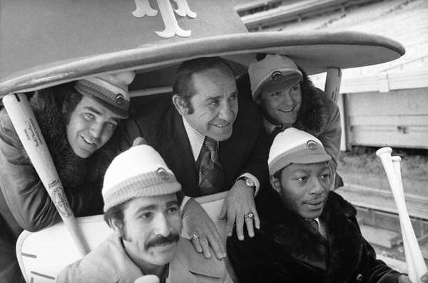 Then-New York Mets Manager Yogi Berra, center, poses