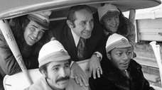 Then-New York Mets Manager Yogi Berra, center, poses