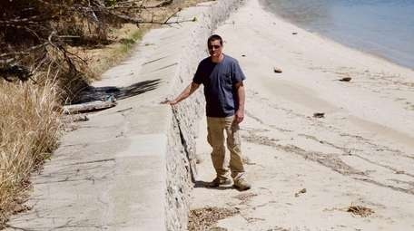 Patrick Glennon stands near a sea wall that