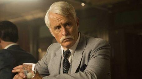 John Slattery as Roger Sterling in