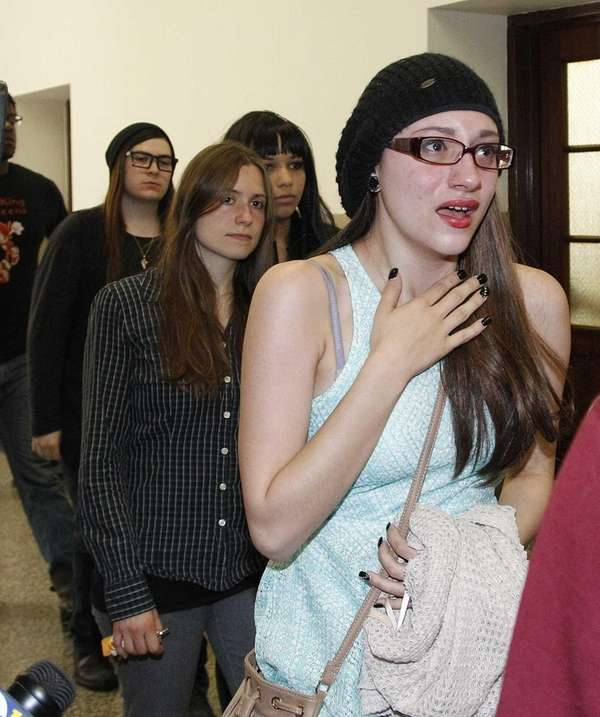 Jazmin Floria, 14, leaves the courtroom after her