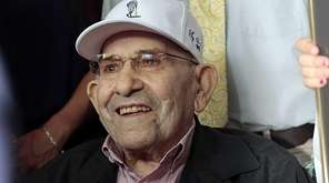 Yogi Berra is seen before the ribbon-cutting ceremony