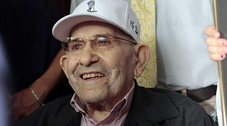 Yogi Berra is seen before the ribbon-cutting ceremony