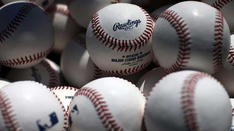 A basket of batting practice balls waits near