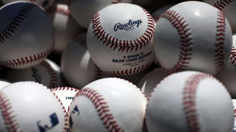 A basket of batting practice balls waits near