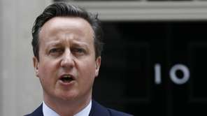 British Prime Minister David Cameron speaks to the
