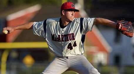 MacArthur pitcher Bobby Lewis (44) delivers a pitch