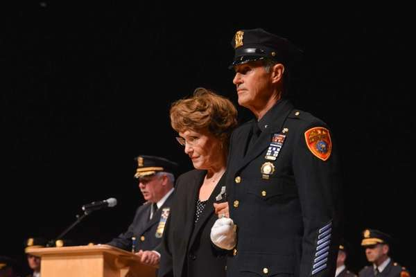 Kathleen Pierri, accepts a Medal of Honor posthumously