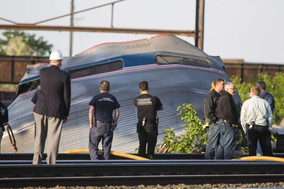 Authorities look at the scene of the Amtrak