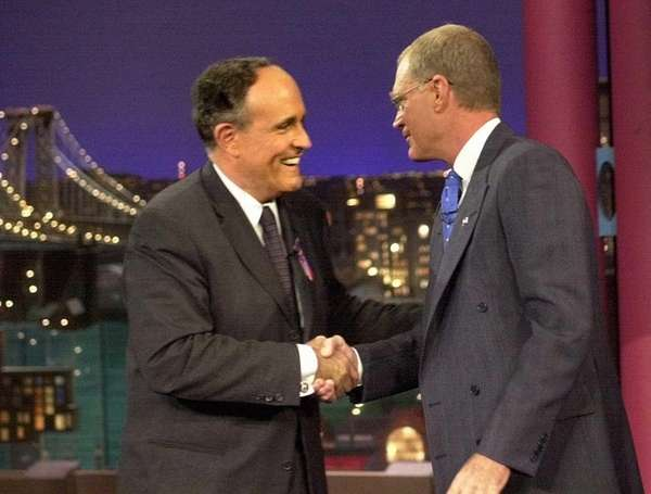 New York City Mayor Rudolph Giuliani, left, is