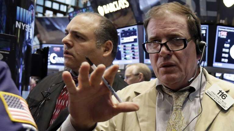 Trader Jonathan Niles, right, gestures his wishes on