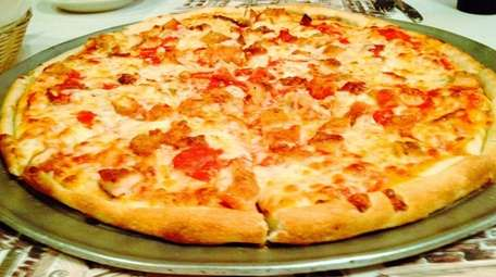 The chicken-cutlet pizza, Parmigiana-style, at Ciro's in Floral