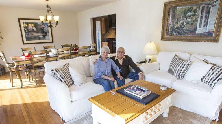 Anita and Tony Macari sit in the living