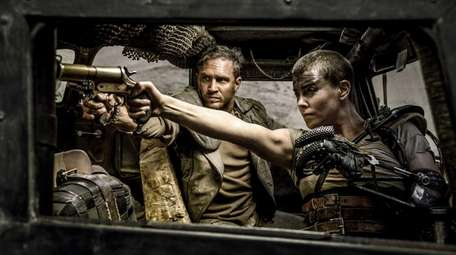 Tom Hardy and Charlize Theron in Warner Bros.