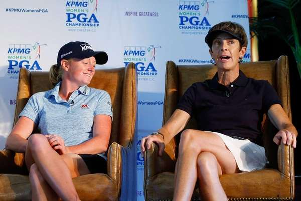 From left, Stacy Lewis and Jean Bartholomew speak