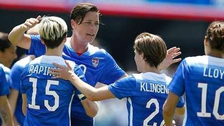 The United States Abby Wambach, center, is congratulated