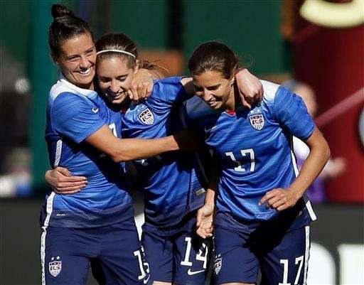 The United States Morgan Brian, center, is congratulated