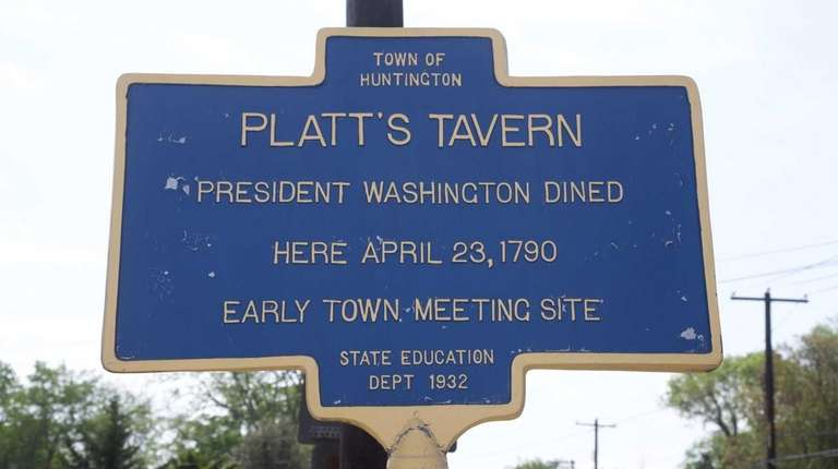 A historic sign about the former Platt's Tavern